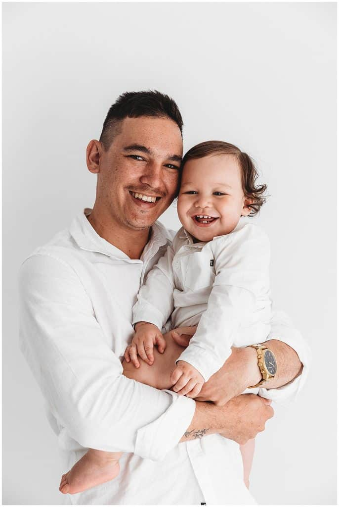 father and son daddy and son portrait by cairns family photographer Lizzy Hannaford Photography