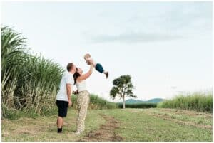 a family photoshoot in cane fields by cairns family photographer Lizzy Hannaford Photography