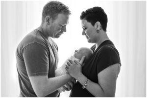 mum dad and newborn baby photo by cairns newborn photographer Lizzy Hannaford Photography