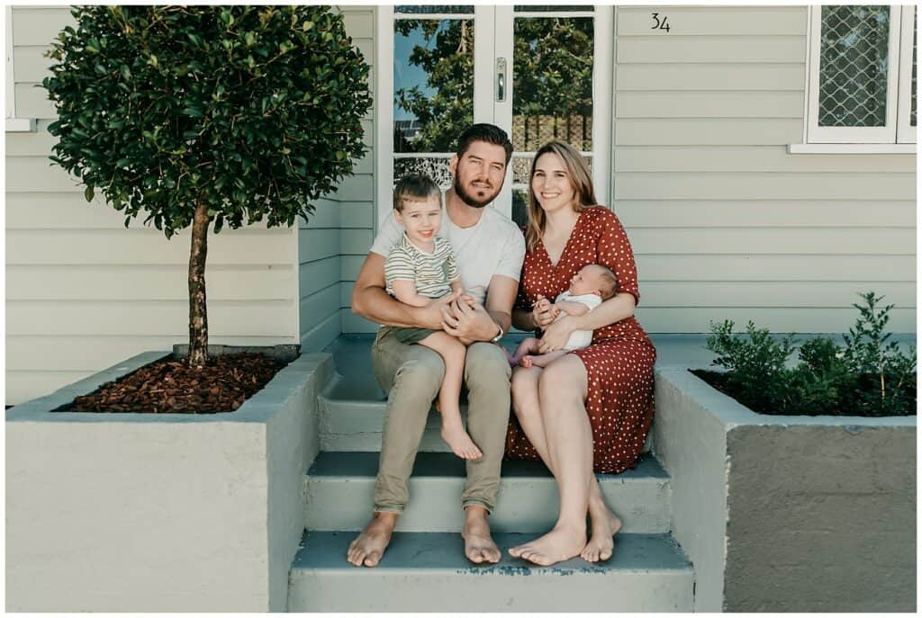 family on front porch by cairns beaches newborn photographer Lizzy Hannaford Photography