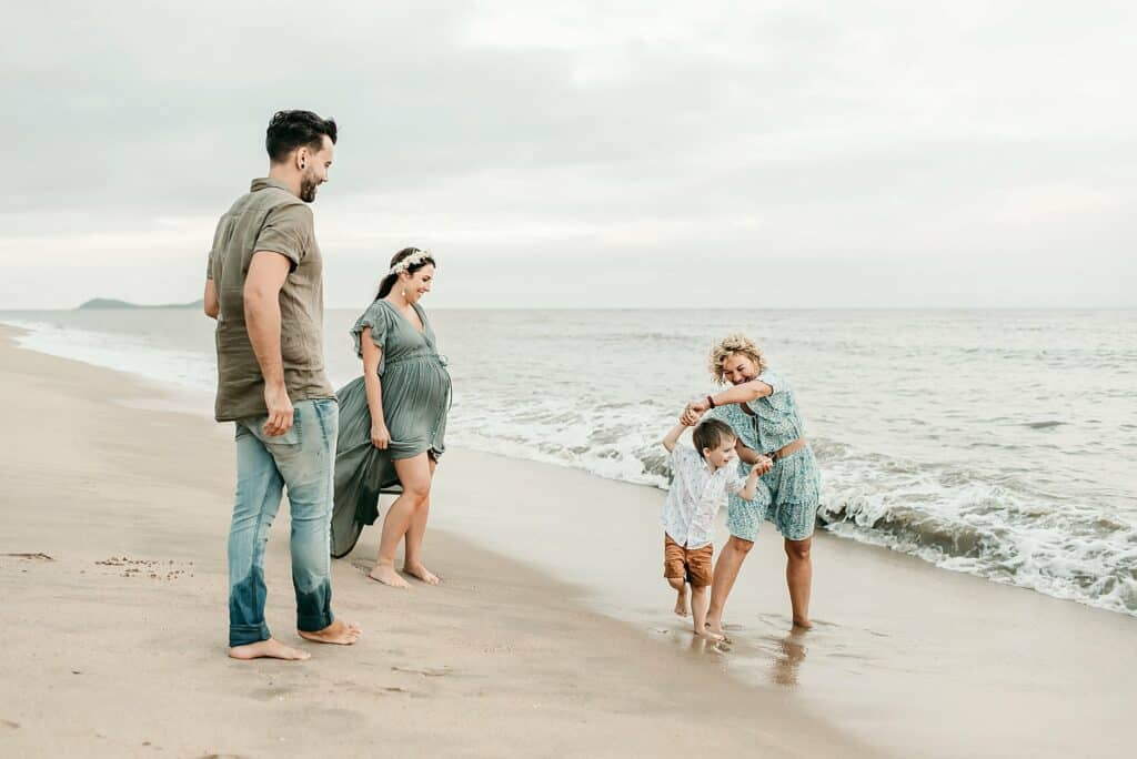 family maternity photoshoot on the beach with cairns maternity photographer Lizzy Hannaford Photography