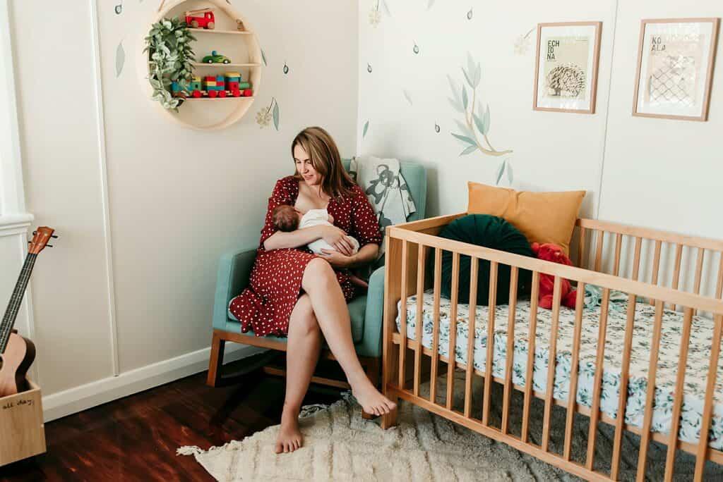 breastfeeding mum by cairns newborn photographer Lizzy Hannaford Photography